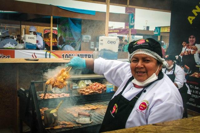 Vendor at Mistura displays her anticuchos